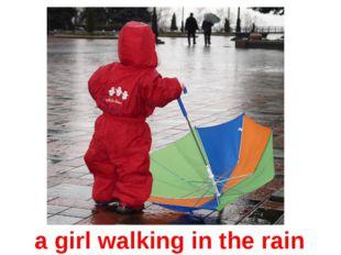a girl walking in the rain