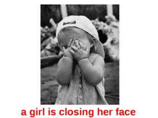 a girl is closing her face