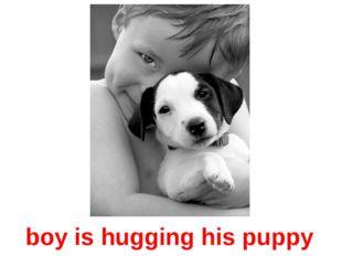 boy is hugging his puppy