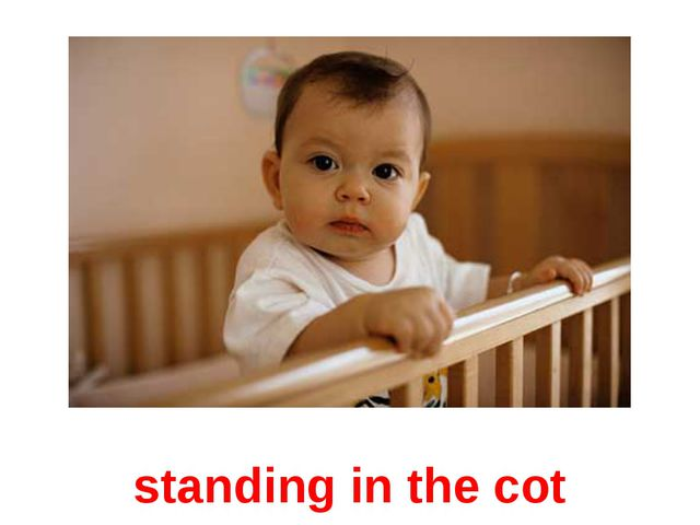 standing in the cot