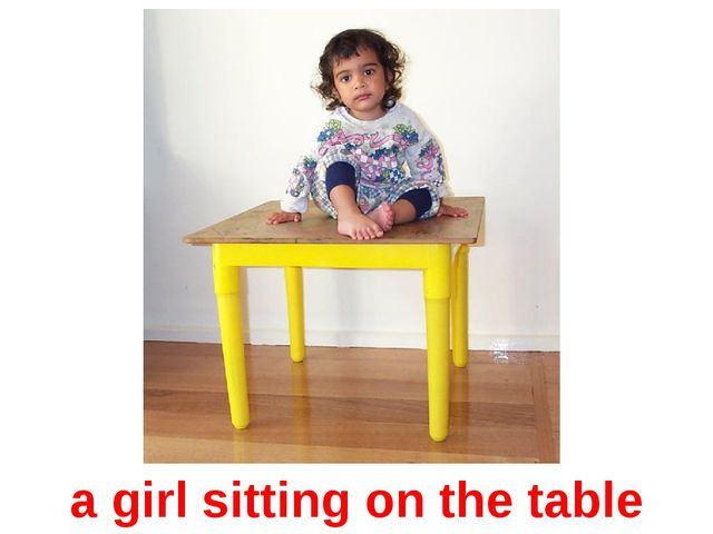 a girl sitting on the table