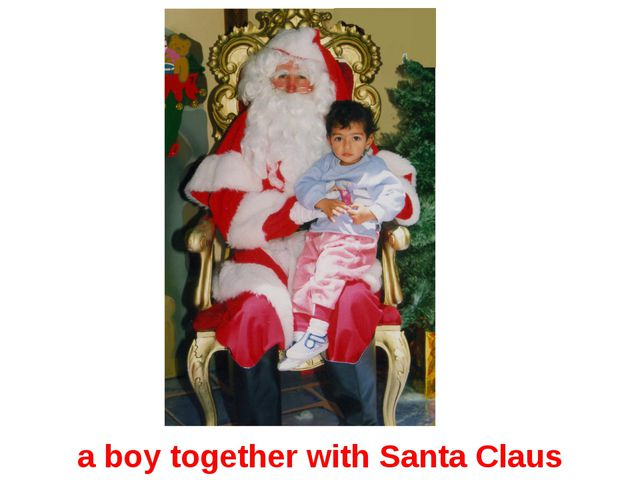 a boy together with Santa Claus
