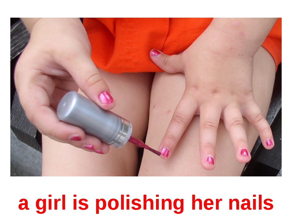 a girl is polishing her nails