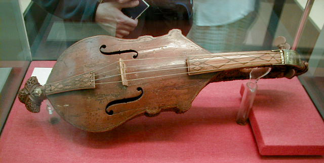 history viola originated and created Viola (n) tenor violin, 1797, from italian viola, from old provençal viola, from medieval latin vitula stringed instrument, perhaps from vitula, roman goddess of joy (see fiddle), or from related latin verb vitulari to exult, be joyful.