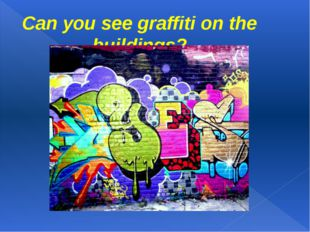 Can you see graffiti on the buildings?