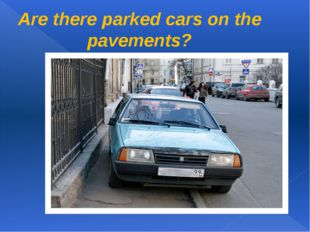 Are there parked cars on the pavements?