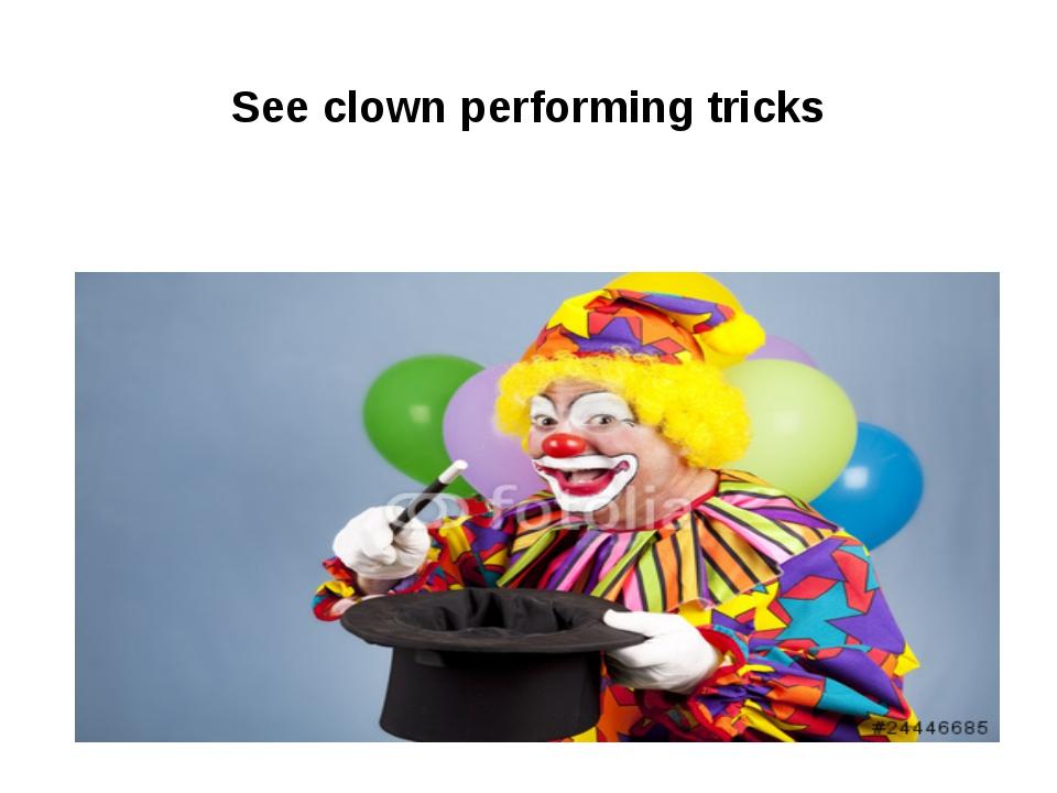 See clown performing tricks