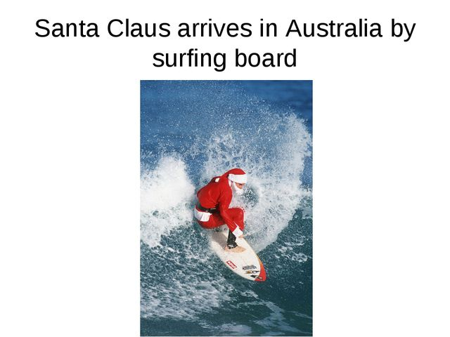 Santa Claus arrives in Australia by surfing board