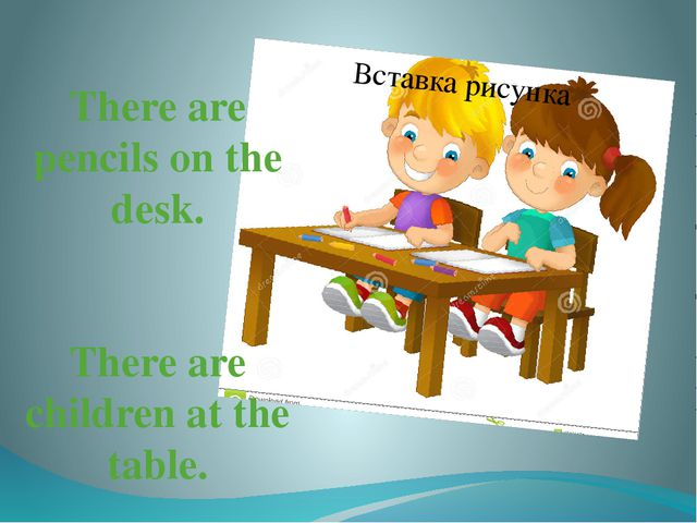 There are pencils on the desk. There are children at the table.