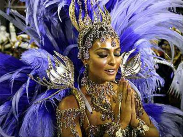 Карнавальное шествие самых титулованных школ самбы каждый год посвящено какой...