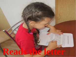 Reads the letter