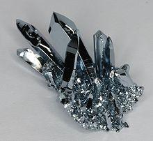 http://upload.wikimedia.org/wikipedia/commons/thumb/8/80/Osmium_cluster.jpg/220px-Osmium_cluster.jpg