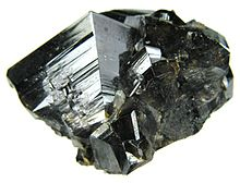 https://upload.wikimedia.org/wikipedia/commons/thumb/c/c4/Cassiterite-121379.jpg/220px-Cassiterite-121379.jpg