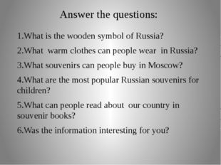 Answer the questions: 1.What is the wooden symbol of Russia? 2.What warm clot