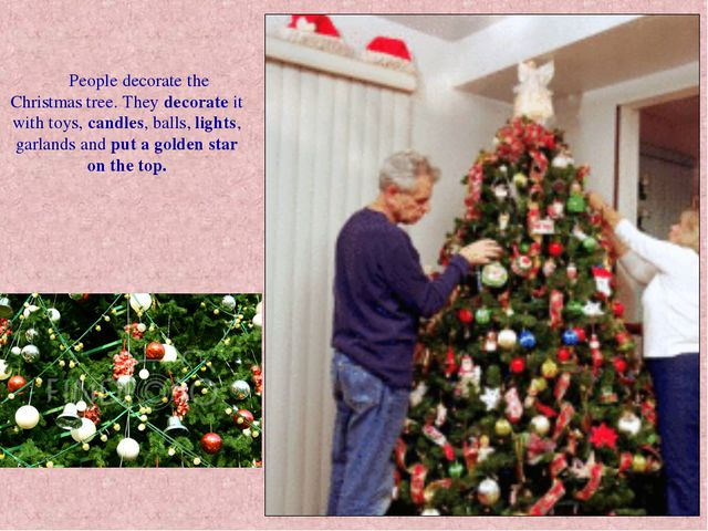 People decorate the Christmas tree. They decorate it with toys, candles, bal...