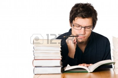 http://us.123rf.com/400wm/400/400/rido/rido1010/rido101000010/7968239-handsome-pensive-young-man-studying-on-a-stack-of-books-on-table-with-a-pencil-in-his-mouth.jpg