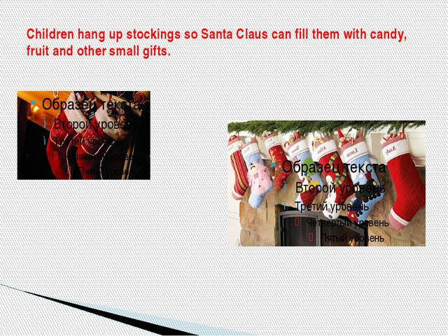 Children hang up stockings so Santa Claus can fill them with candy, fruit and...
