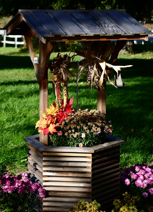 Колодец для цветов фото